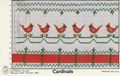Pretty red cardinals with green accents and red ribbon smocking design by Mollie Jane Taylor. Available at www.chadwickheirlooms.com