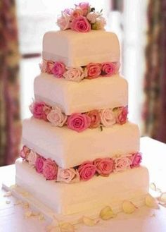 White four tier square wedding cake with fresh roses. I like the square cake