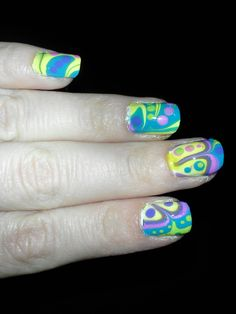 60's Easter Egg Nails! This is one of my original designs. I did water marbling with lavender, teal, pink, and yellow. Afterward I went back over it with dotting tools and added a few dots here and there to make it more interesting. This is a fun, bright, and eye-catching design. I received a lot of nice compliments for this one =)