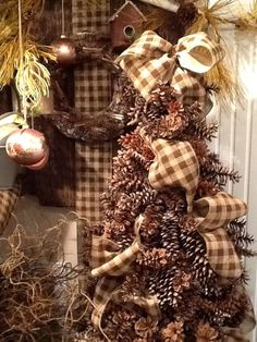 Make a pine cone Christmas tree out of a tomato cage and Burlap RIbbon