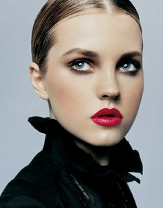 Beautiful make up with deep pink lips.