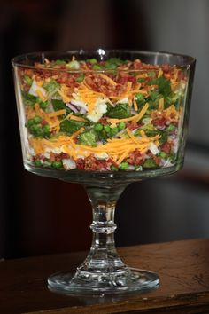 Seven Layer Salad Recipe Lettuce, frozen peas, chopped boiled egg, bacon, cheese, green onions, dressing....layer again... Dressing: 1c. sour cream, 1c. mayo, 2 tablespoons vinegar,1/2 cup sugar, salt