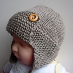 "Baby Aviator Hat - Regan  Creepy doll model aside, I love this aviator cap.  Sizing goes up to 20-21"", I could totally make this for me.... Or one of my nephews, they like hats, too."