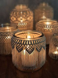 6.5 tall x 6.5 wide with 5 opening glass jar. Covered with 1.5 mm unbleached cotton macrame string. Add some sand and a candle & it becomes the perfect bohemian candle holder. Fill it with flowers for a unique vase. Group several together for a table centerpiece. Great for