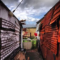 colourful corrugated iron homes in a Masiphumelele back alley, Cape Town, South Africa . Landscape Photography, Art Photography, Tin Art, Slums, Cape Town, Pretty Pictures, South Africa, To Go, World