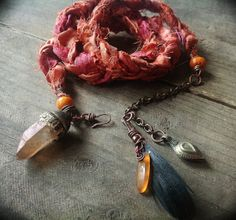 Tribal silk wrap bracelet / necklace in burnt orange with quartz crystal,  feather and carnelian charms