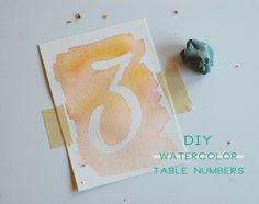DIY watercolor table numbers.  Can do many more things with this idea.