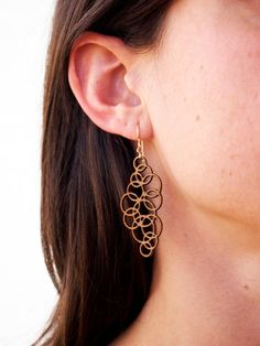 laser cut wood earrings by folia designs