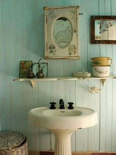 Pedestal sink with a small mirror for the bathroom.