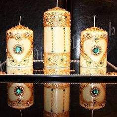 Beautiful white candles with a gold henna design. Heart themed design