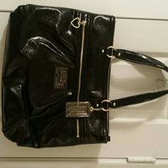 Coach black shoulder bag Authentic coach bag with gold zipper detail. Never used. New with tag. Box available Coach Bags Shoulder Bags