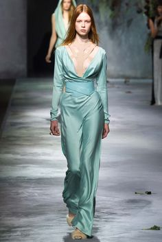 Vionnet - Fall 2015 Ready-to-Wear - Sea glass green belted, long sleeved gown with low cut decollete and nude cage bra.