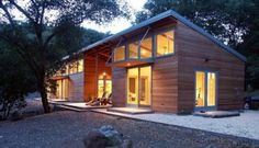 The blending of a home's interior and the outdoors, while reconciling modern style with warmth—those were the goals for this open, light filled house. Simple details, an open floor plan, and the orderly use of natural materials let this house at once complement and co-exist with its wooded surroundings.