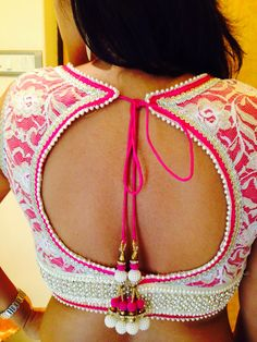 Bridal saree blouse design. Love the pink and the tassels.