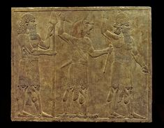 Alabaster wall panel; relief; from left to right a Lahmu, Ugallu or great lion and the house god; the Lahmu has hair in elaborate ringlets and tasselled kilt; he balances a spear on the ground and the sheath of his dagger is carved with an animal's head