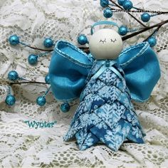 Kit and Pattern for a quilted no sew angel ornament. This beautiful turquoise with snowflakes angel will be a beautiful addition to your Christmas décor.