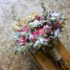 native summer wedding bouquet with gum nuts, flowering gum, protea, brunia…