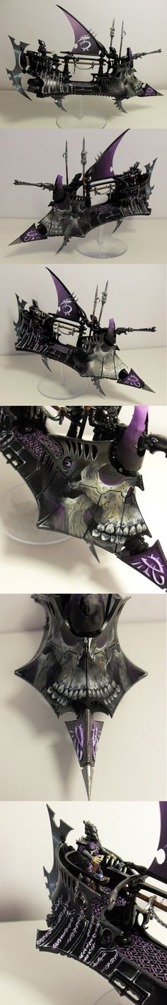 Warhammer 40k. I'm not a fan at all of the Dark Eldar, but this free-hand painting was just too good not to pin