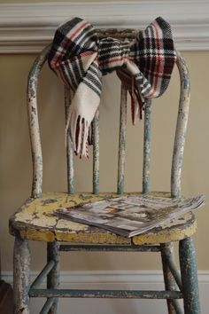 such a simple goodie for winter decor - plaid scarf on an old chair...and a stack of old books would be sweet. by luella