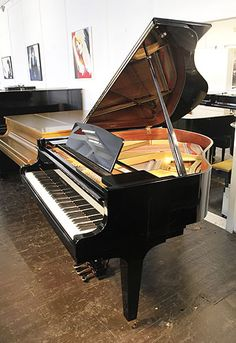 A 2000, Kawai KF-1 baby grand piano for sale with a black case and square, tapered legs at Besbrode Pianos £6500