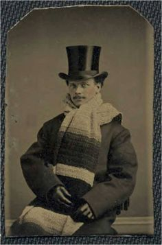Vintage photo, man wearing a massive scarf, hand-painted rosy cheeks.