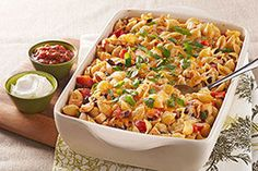 Enchilada Pasta Bake — Pasta shells, roasted chicken breast and black beans put the hearty in this cheesy and easy-to-make enchilada bake recipe. Use gf pasta Baked Pasta Recipes, Baking Recipes, Chicken Recipes, Fun Recipes, Pasta Recipies, Dinner Recipes, Recipe Pasta, Recipe Chicken, Noodle Recipes