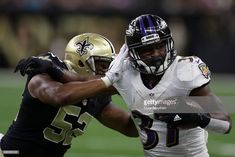 Javorius Allen of the Baltimore Ravens is tackled by Craig Robertson of the New Orleans Saints at the Mercedes-Benz Superdome on September 2016 in New Orleans, Louisiana. Get premium, high resolution news photos at Getty Images Nfl Football Players, Football Helmets, Baltimore Ravens, New Orleans Saints, News, Check