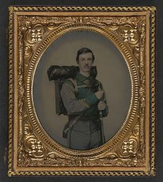 """[Unidentified soldier in Confederate uniform of Co. E, """"Lynchburg Rifles,"""" 11th Virginia Infantry Volunteers holding 1841 """"Mississippi"""" rifle, Sheffield-type Bowie knife, canteen, box knapsack, blanket roll, and cartridge box] (LOC) by The Library of Congress, via Flickr"""