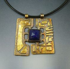 Bespoke pendant by Oblivion Jewellery. Sterling silver fused with a layer of 24k gold and a rose cut lapis lazuli.