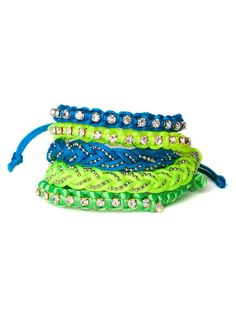 This striking set of bracelets hits two major trends in a truly fun way—neon colors and the surf motif. With its braided, woven details and sparkling embellishments, it's also a perfect combo of craft and glamour.