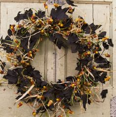 "Spooktacular - Halloween Silk Wreath 18"" Trick or treat, smell my....., you get the idea, with this incredibly sweet looking Halloween Candy Silk Wreath. At eighteen inches wide this wreath can be placed just about anywhere, with dark leaves and dancing golden colored candy corn swirling around in a fun circle. Sprouts of dried grass pieces are breaking up the darkness and adding a lot of wisp to this seasonal creation. Ships for free! $63.99"