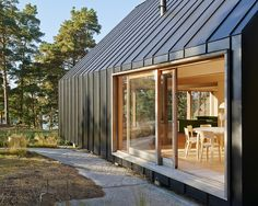 Modern Metal-Clad House Husarö is Nestled High on a Swedish Island Hillside | Inhabitat - Green Design, Innovation, Architecture, Green Building