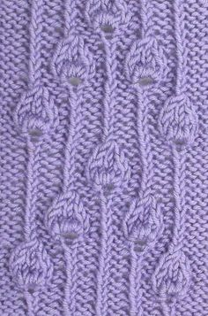 Embossed Buds Panel, utilizies the same stitch in a different arrangement.  It is also found in the Textured Stitches category.