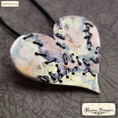 Handmade Brass and Copper Mended Heart Pendant