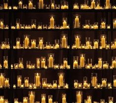 Candle wall. Perhaps not possible to do an entire wall, but perhaps this can be constructed behind the bridal party table or on those slanted ladder style shelves  near the bridal table.