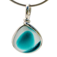 Intense mixed teal or aqua sea glass found on the beaches of Seaham England set in our Original Wire bezel© pendant setting in sterling silver.
