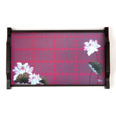 This tamara Tray has a picturesque imagery of the beautiful Lotus flower in the background of a beautiful pink geometrical design crafted. The rectangular tray is is made of wood and has an elegant, royal shape handle. Material WoodDimensions S - 8