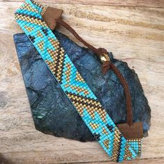 This is a fully adjustable, vegan, loom beaded bracelet made with the finest materials available. I weave each piece by hand with my little loom in Cumbria, England. The Gilded Turquoise design features Miyuki Delica beads in mint, turquoise, shining and matte gold, and bronze. It has an