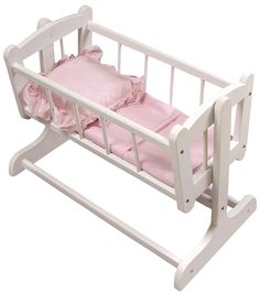 Pretty Wooden Baby Cradle with White Themed Style Color Decorating Ideas and Cute Checkered Pattern Pink Mattress complete with the Pillows for Furniture in the Baby Room