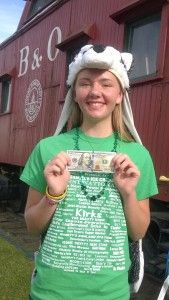 Miss Hayley Jackson and her Hundred Dollar Bill by the Caboose at the B&O Depot.
