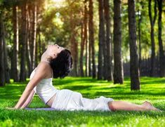 Yoga cobra pose in the park. Yoga bhujangasana cobra pose by woman in white cost , Improve Flexibility, Flexibility Workout, Inner Thigh Stretches, Tricep Stretch, Intense Cardio Workout, White Blood Cell Count, Cobra Pose, White Costumes, Yoga Posen