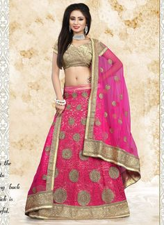 Add grace and charm to your appearance in this beautiful hot pink net a line lehenga choli. The ethnic embroidered and patch border work for the dress adds a sign of beauty statement with a look. Come...