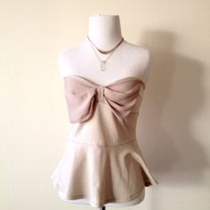 Strapless Peplum Top Cute strapless top flares out at bottom and is decorated with a sweet bow Tops Tank Tops