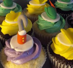Peter Pan Themed Cupcakes by Clever Cupcakes via | Flickr - Photo Sharing! Chocolate and Vanilla Cupcakes topped with Vanilla Buttercream and handmade fondant Peter Pan hats, Tinkerbell wings, and Captain Hook's hook.