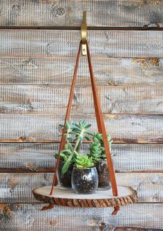 use rope, twine, fabric or leather straps to hang your new wood slice shelf