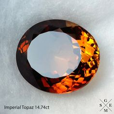 Topaz of deep golden-yellow color is called Imperial topaz  Product name: natural Imperial Topaz Shape: oval facet Weight: 14.74ct Size: 16.5 x 14 x 8 mm
