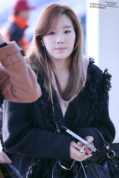Taeyeon's airport fashion