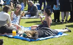 One woman was seen lying face-down on a picnic rug as her three friends enjoyed a glass of prosecco in the sunshine Melbourne Cup, Stakes Day, Picnic Blanket, Outdoor Blanket, Three Friends, Face Down, Prosecco, Grass, Carnival