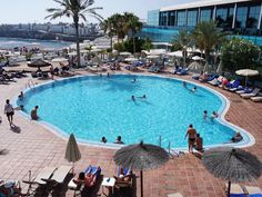 Another obligatory #swimming #pool and #palmtree #photo from the #Sandos #Papagayo Beach #Resort #Hotel in #PlayaBlanca #Lanzarote. This is another one of five pools at the resort. #IgersLanzarote #IgersSpain #building  #hospitality #travel #tourism #tourist #leisure #life #VisitSpain #VisitLanzarote #IgersEspana #España #CanaryIslands #swimmingpool #water #holiday #vacation #fun #SandosPapagayo
