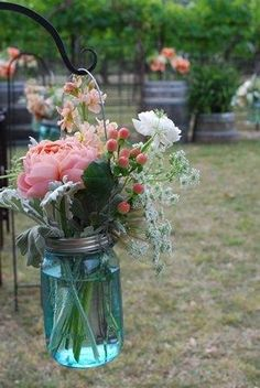 turquoise with baby's breath....it' s cheap and we could do it ourselves! soooo cute!!